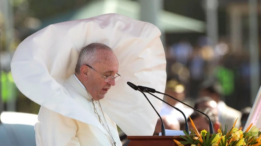 Wind blows Pope Francis' mantle as he delivers his speech at Colombo's International airport, Sri Lanka, Tuesday, Jan. 13, 2015.  Pope Francis arrived in Sri Lanka Tuesday at the start of a weeklong Asian tour saying the island nation can't fully heal from a quarter-century of ethnic civil war without pursuing truth for the injustices committed. (AP Photo/Alessandra Tarantino)