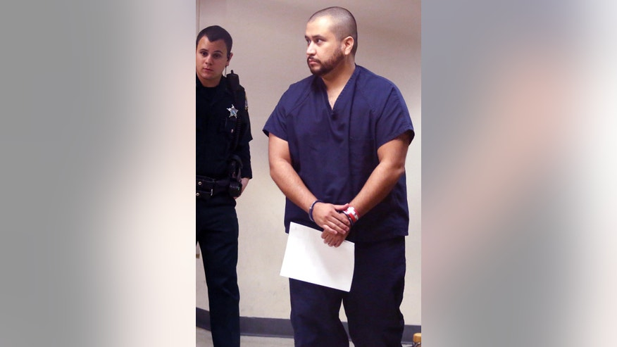 Zimmerman in handcuffs at the Seminole County Courthouse in Sanford, Fla. on Sat. Jan. 10, 2015.