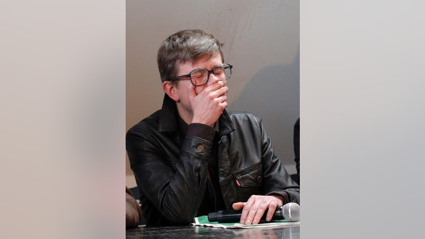 Cartoonist Renald Luzier, known as Luz attends a press conference in Paris, France, Tuesday, Jan. 13, 2015.  Twelve people died when two masked gunmen assaulted the newspaper's offices on Jan. 7, including much of the editorial staff and two police. It was the beginning of three days of terror around Paris that saw 17 people killed before the three Islamic extremist attackers were gunned down by security forces. Charlie Hebdo had faced repeated threats for depictions of the prophet, and its editor and his police bodyguard were the first to die. (AP Photo/Christophe Ena)