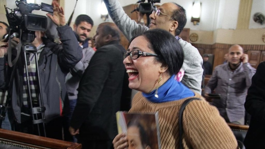 A supporter of ousted President Hisni Mubarak reacts in a courtroom to a verdict ordering a retrial in Cairo, Egypt, Tuesday, Jan. 13, 2015. Egypt's top appeals court has ordered the retrial of deposed President Hosni Mubarak and his two sons in a corruption case, a move that could pave the way for the former autocrat's release. (AP Photo/Ahmed Abd El-Gwad, El Shorouk Newspaper) EGYPT OUT