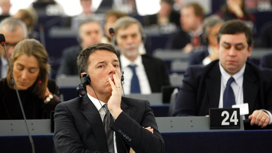 Italian Prime Minister Matteo Renzi attends the European Parliament in Strasbourg, eastern France, Tuesday Jan. 13, 2015. Renzi reviewed the outgoing EU presidency. (AP Photo/Christian Lutz)