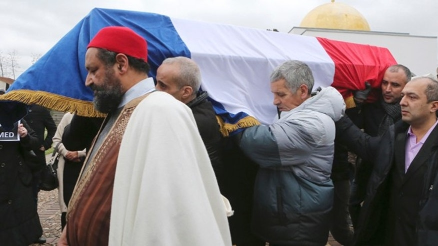 Jan. 13, 2015: People carry the coffin of slain police officer Ahmed Merabet after a funeral service at the Bobigny Mosque, east of Paris, France. Merabet, a French Muslim policeman, was one of the victims, killed as he lay wounded on the ground as the gunmen, brothers Said and Cherif Kouachi, made their escape after the killing at Charlie Hebdo newspaper.