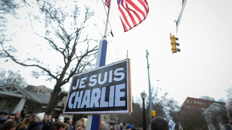 "Jan. 11, 2015: A sign reading ""Je Suis Charlie"" (I am Charlie) is on display during a silent walk in Atlanta to support France after a three-day terrorism spree around Paris that killed 17 people last week. (AP)"