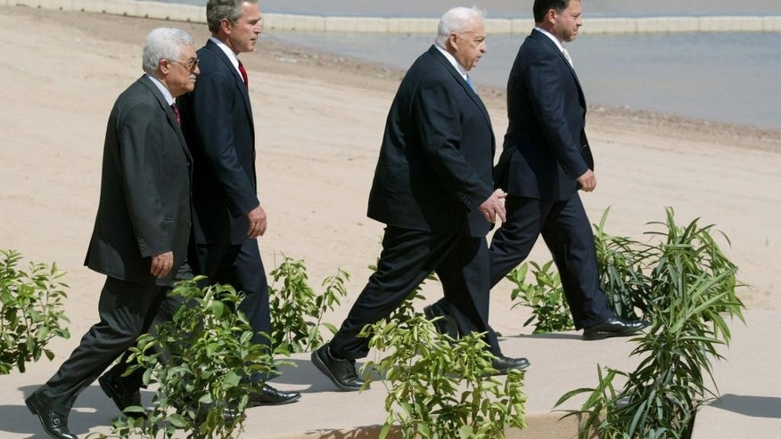 FILE - In this June 4, 2003 file photo, from left to right, Palestinian Prime Minister Mahmoud Abbas, President Bush, Israeli Prime Minister Ariel Sharon and Jordanian King Abdullah make their way to the podium to read their statements after their summit at the monarch's palace in the Jordanian Red Sea resort of Aqaba. After a decade in power, Abbas is no closer to a deal on Palestinian statehood, has failed to reclaim the Gaza Strip from political rival Hamas and is being disparaged by some as a pliant guardian of Israeli security needs in the West Bank. (AP Photo/Pool, Menahem Kahana, File)
