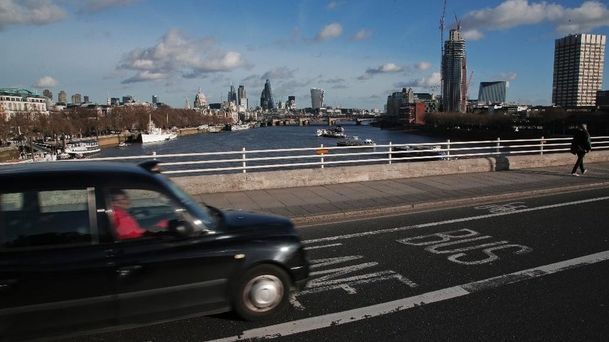 A London taxi driver uses a bus lane on a bridge over the river Thames in central London, Wednesday, Jan. 14, 2015. The European Union court has handed London's embattled taxi drivers some good news _ they can keep their right to drive in bus lanes. Drivers of London's iconic _ but expensive _ black cabs face increasing competition from cheaper private cab firms and drivers from ride-sharing apps such as Uber. One advantage is a rule allowing them _ but not Uber drivers or private taxis known as minicabs _ to move around quickly by using lanes set aside for buses.(AP Photo/Lefteris Pitarakis)