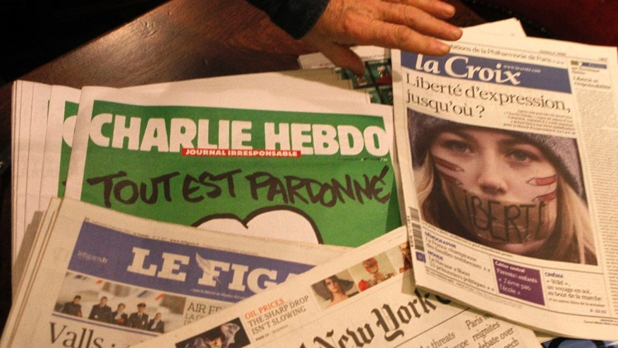 Jan. 14, 2015: Copies of the latest issue of Charlie Hebdo newspaper are sold with other newspapers at a newsstand in Lille, northern France.