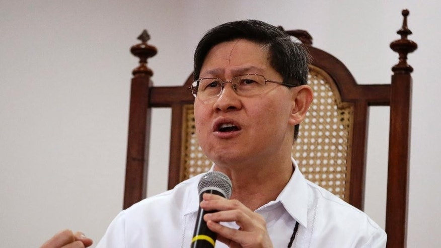 In this Jan. 10, 2015 photo, Manila Archbishop Cardinal Luis Antonio Tagle talks about the forthcoming visit of Pope Francis during a forum with students in Manila, Philippines. Pope Francis will be welcomed in the Catholic heartland on Thursday, Jan. 15, 2015, by the Filipino cardinal who might one day succeed him: a boyish-looking priest who rode the bus as a bishop and has impressed many with a humble life, intellect and compassion for the poor. (AP Photo/Bullit Marquez)