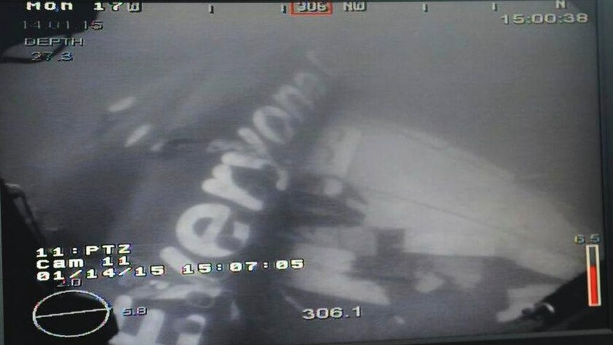 This undated underwater photo taken by a Remotely Operated Vehicle (ROV) and released by the Singapore Ministry of Defence (MINDEF) shows the wreckage of AirAsia Flight QZ 8501 lying on the sea floor in the Java Sea. A Singaporean navy ship has located the fuselage of the crashed AirAsia plane in the Java Sea, Singapore's defense minister said Wednesday. (AP Photo/MINDEF)
