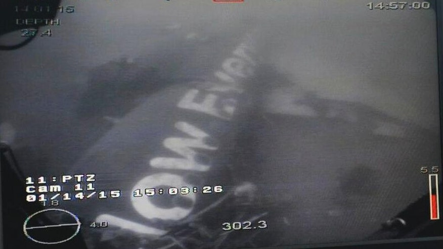 This undated underwater photo taken by a Remotely Operated Vehicle (ROV) and released by the Singapore Ministry of Defense (MINDEF) shows the wreckage of AirAsia Flight QZ 8501 lying on the sea floor in the Java Sea. A Singaporean navy ship has located the fuselage of the crashed AirAsia plane in the Java Sea, Singapore's defense minister said Wednesday. (AP Photo/MINDEF)