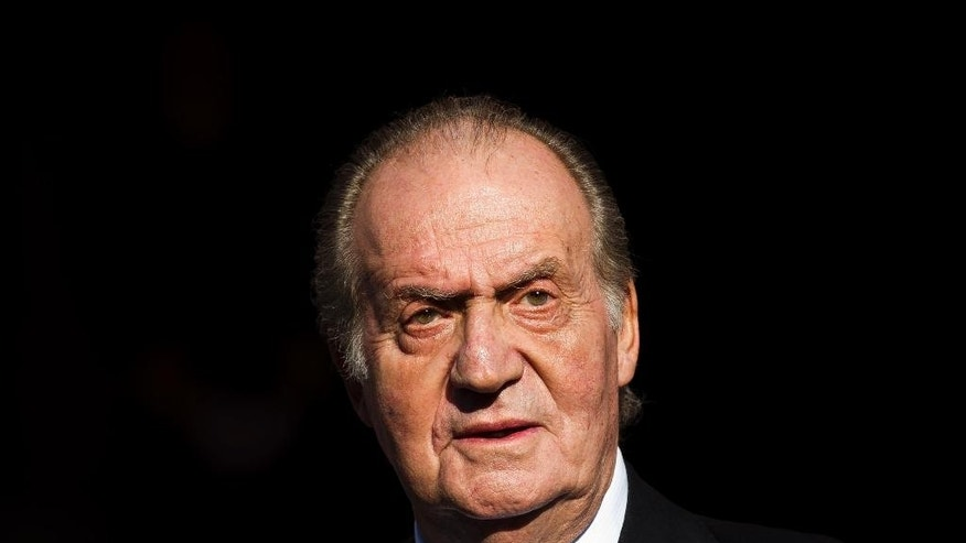 FILE - In this Tuesday, Dec. 27, 2011, file photo, Spain's King Juan Carlos leaves after the official opening of the Parliament, in Madrid. Spain's Supreme Court said Wednesday Jan. 14, 2015, it will investigate a paternity claim filed against former King Juan Carlos by a Belgian woman alleges she is his daughter and was born after her mother had a relationship with him in the 1960s while he was crown prince.  Carlos while king was immune from criminal prosecution and civil lawsuits, but lost immunity after he abdicated in June 2014. (AP Photo/Daniel Ochoa de Olza, File)