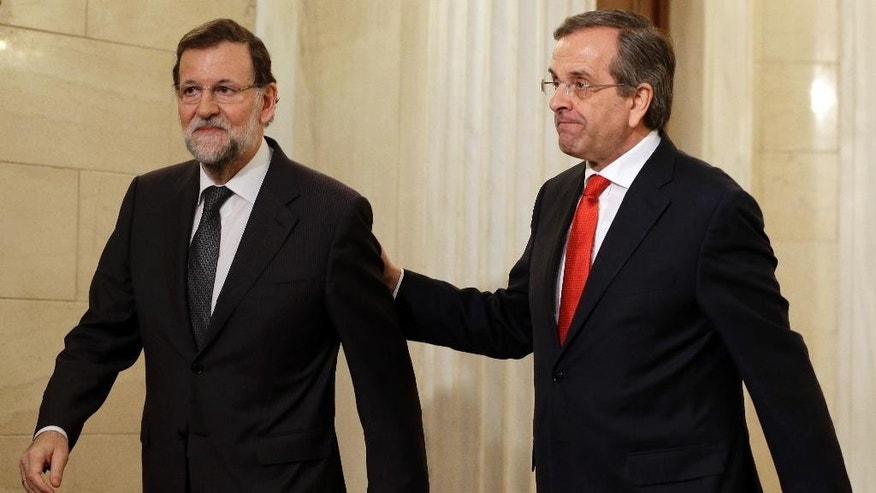 Greece's Prime Minister Antonis Samaras, right, and Spanish counterpart Mariano Rajoy leave Maximos Mansion after their meeting in Athens on Wednesday, Jan. 14, 2015. Rajoy is in Greece to express support for the country's draconian bailout program, ahead of a general election that could see his fellow conservatives lose power to leftwing challengers. (AP Photo/Thanassis Stavrakis)