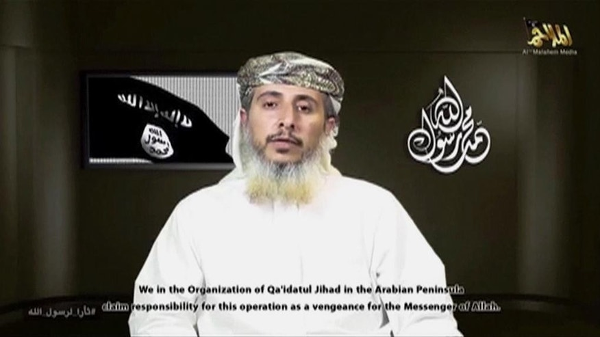 AP CANNOT INDEPENDENTLY VERIFY THE CONTENT, DATE, LOCATION OR AUTHENTICITY OF THIS MATERIAL IN THIS IMAGE - In this image made from militant video posted on the Twitter account of Yemen's al-Qaida branch on Wednesday, Jan. 14, 2015, Nasr al-Ansi, a top commander of al-Qaida in the Arabian Peninsula, speaks about last week's deadly assault on a French satirical newspaper. Al-Ansi confirmed in the video that his group carried out the attack to avenge cartoons depicting the Prophet Muhammad, as he called for unity among jihadi ranks and vowed more attacks on the West. (AP Photo/Militant Video)