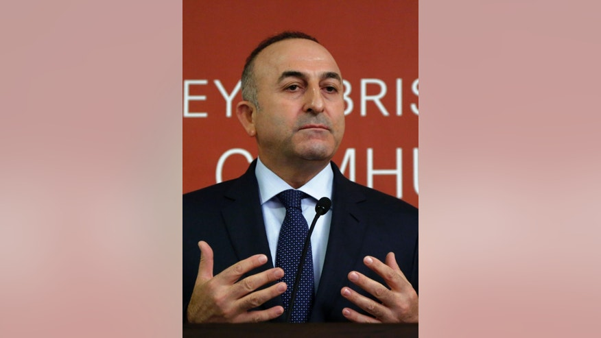 """Turkish Foreign Minister Mevlut Cavusoglu, speaks to the media after a meeting with Turkish Cypriot leader Dervis Eroglou in the Turkish Cypriot breakaway north of the divided capital Nicosia, Wednesday, Jan 14 , 2015. United Nations envoy for Cyprus, Norway's Espen Barth Eide says deadlocked talks to reunify ethnically split Cyprus are """"moving in the wrong direction"""" amid a dispute over rights to search for offshore gas. Cavusoglu is in Cyprus for one-day visit for talks. (AP Photo/Petros Karadjias)"""