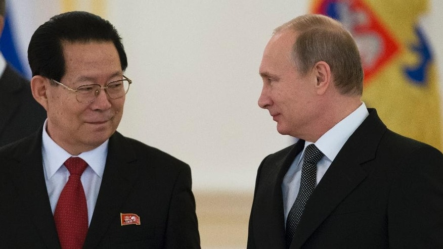 Nov. 19, 2014: North Korea's new Ambassador to Russia Kim Hyun Joon, left, poses with Russian President Vladimir Putin for a photo after presenting his credentials from North Korean leader Kim Jong Un to Putin in the Kremlin in Moscow, Russia. After three years of watching his fellow leaders mix and mingle while he was secluded in Pyongyang, Kim Jong Un is looking more and more likely to visit Russia in his first trip abroad since taking power in the world's first look at the young North Korean leader at work on the international stage.