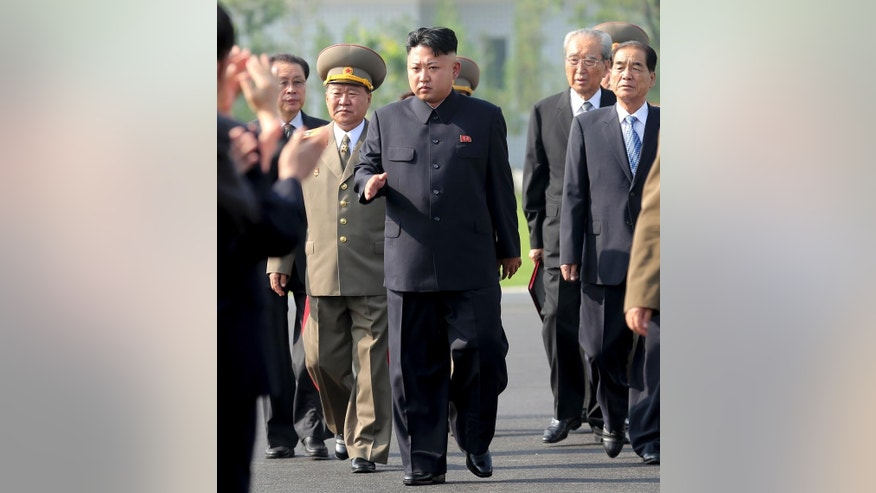 July 25, 2013: North Korean leader Kim Jong Un, center, arrives at the cemeteries of fallen fighters of the Korean People's Army (KPA) in Pyongyang, North Korea.