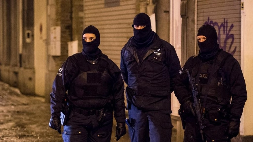 Belgian police officers guard a street in Verviers, Belgium, Thursday, Jan. 15, 2015. Belgian authorities say two people have been killed and one has been arrested during a shootout in an anti-terrorist operation in the eastern city of Verviers. (AP Photo/Geert Vanden Wijngaert)