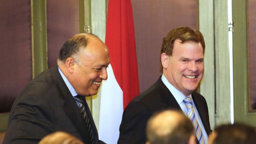 """Canadian Foreign Minister John Baird, right, is accompanied by his Egyptian counterpart Sameh Shukri following a press conference  at the Egyptian foreign ministry in Cairo, Egypt, Thursday, Jan. 15, 2015. Baird says he held """"constructive and fruitful"""" discussions with his Egyptian counterpart over resolution of the case of a Canadian-Egyptian journalist from Al-Jazeera English held over a year in terrorism-related charges along with two others. (AP Photo/Amr Nabil)"""