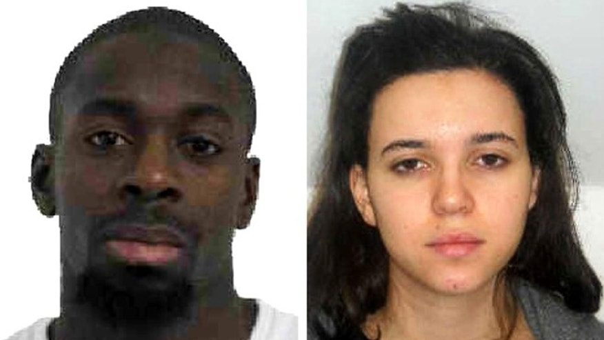 Pictured in this composite of handout photos provided by the Direction Centrale de la Police Judiciaire on January 9, 2015 are Amedy Coulibaly, aged 32, (L) who is wanted in connection with the shooting of a French policewoman yesterday and suspected as being involved in the ongoing hostage situation at a Kosher store in the Porte de Vincennes area of Paris, and known associate Hayat Boumeddiene, aged 26. (Photo by Direction centrale de la Police judiciaire via Getty Images)