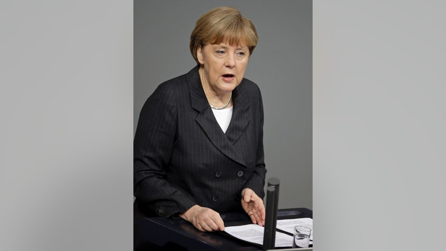 German Chancellor Angela Merkel speaks during a meeting of the German federal parliament, Bundestag, in Berlin, Germany, Thursday, Jan. 15, 2015. (AP Photo/Michael Sohn)