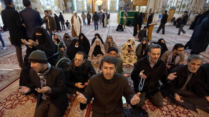 In this Thursday, Jan. 8, 2015 photo, Iranian pilgrims pray at the holy shrine of Imam Ali shrine in the Shiite holy city of Najaf, Iraq. The shift by the Iranian-born Grand Ayatollah Ali al-Sistani underlines the key role played by religion in post-Saddam Hussein Iraq and takes the troubled country down a potentially dangerous path, given its deep sectarian and ethnic tensions. His role may fall well short of Iranian-style theocracy where the top cleric has the final word on everything, but Iraq's government clearly feels it must listen to him. (AP Photo/Hadi Mizban)
