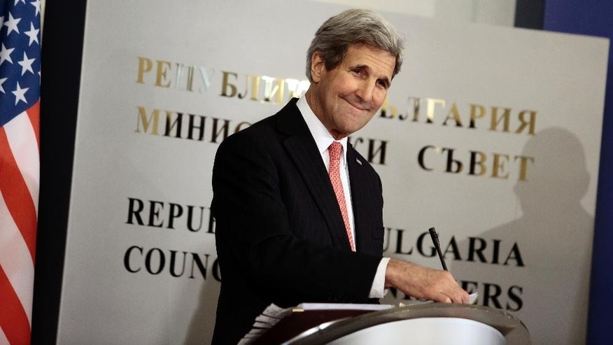 US Secretary of State, John Kerry, smiles during a press-conference at the Council of Ministers building in Sofia, Bulgaria, Thursday, Jan. 15, 2015. Kerry is in Bulgaria to discuss security cooperation, energy diversification, and the bilateral trade and investment relationship. (AP Photo/Valentina Petrova)