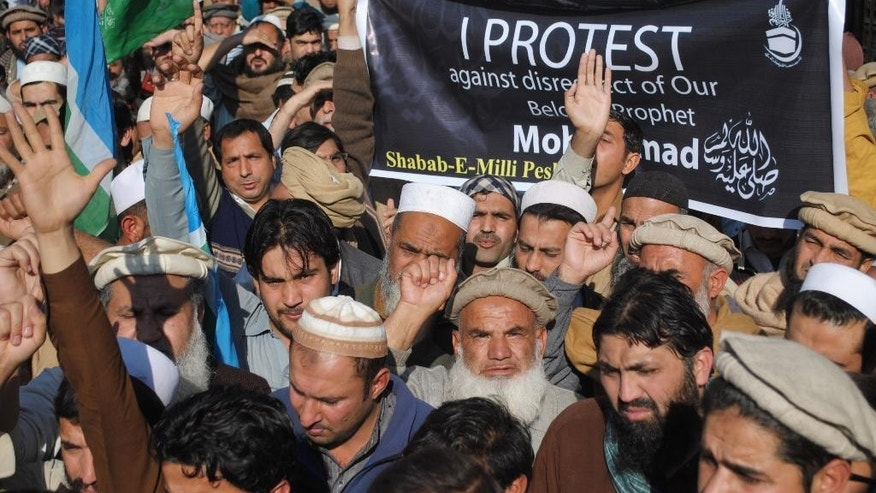 Supporters of a Pakistani religious party Jamaat-i-Islami rally to protest against caricatures published in French magazine Charlie Hebdo, in Peshawar, Pakistan, Friday, Jan. 16, 2015. Pakistani students are clashing with police during protests against the French satirical magazine that was attacked last week for publishing images of the Prophet Muhammad. (AP Photo/Mohammad Sajjad)