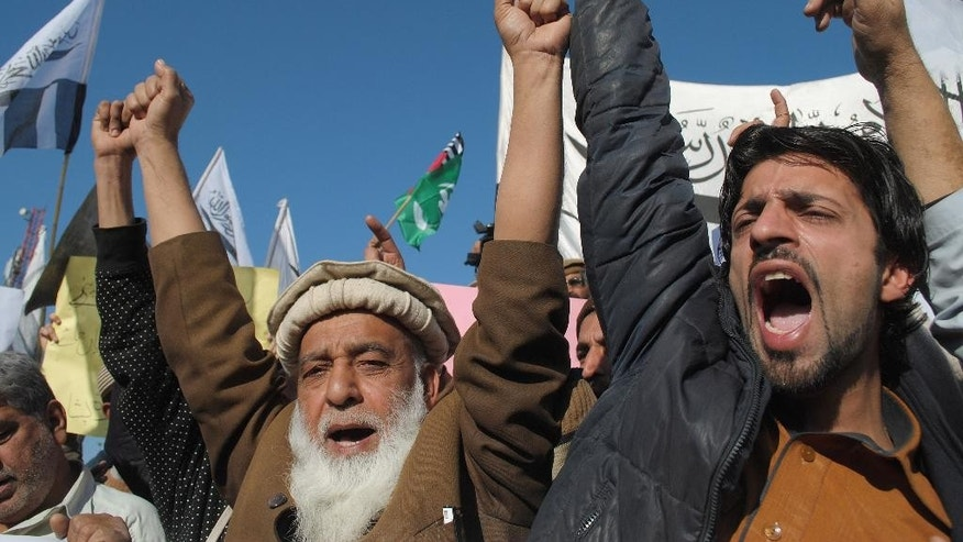 Pakistani protesters chant slogans against caricatures published in French magazine Charlie Hebdo, in Peshawar, Pakistan, Friday, Jan. 16, 2015. Pakistani students are clashing with police during protests against the French satirical magazine that was attacked last week for publishing images of the Prophet Muhammad. (AP Photo/Mohammad Sajjad)