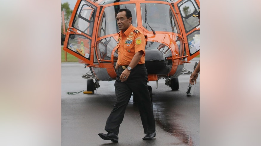 Chief of National Search And Rescue Agency (BASARNAS) F. Henry Bambang Soelistyo, walks after a search operation for AirAsia Flight 8501 upon arrival at the airport in Pangkalan Bun, Indonesia, Indonesia, Friday, Jan. 16, 2015. Bad weather and poor underwater visibility have prevented Indonesian navy divers from searching inside the large chuck of AirAsia jet wreckage that's believed to be the fuselage. (AP Photo/Achmad Ibrahim)