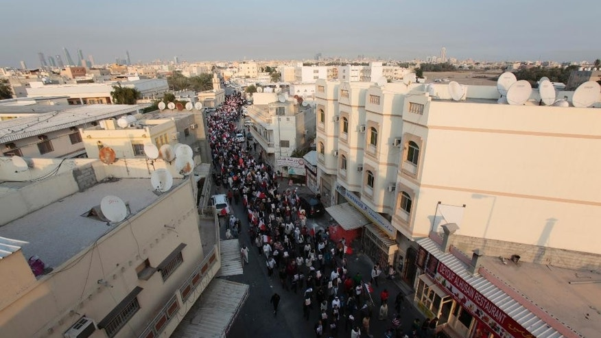 Bahraini anti-government protesters march in support of jailed activists in Bilad al-Qadeem, Bahrain, Friday, Jan. 16, 2015. Protests and daily clashes have been escalating since the arrest of Shiite opposition leader Sheikh Ali Salman on Dec. 28. (AP Photo/Hasan Jamali)