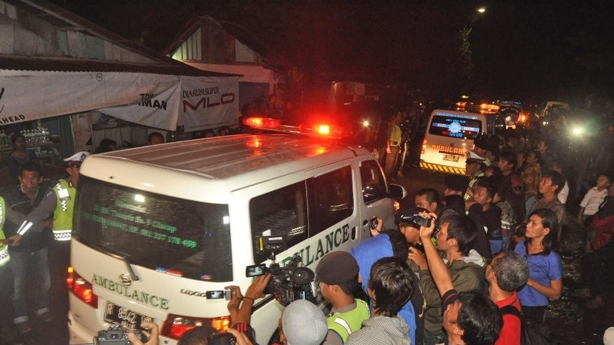 Ambulances carrying the body of drug convicts Brazilian national Marco Archer Cardoso Moreira, left, and Dutch national Ang Kiem Soe leave upon arrival from Nusakambangan island where their executions were held, at Wijayapura port in Cilacap, Central Java, Indonesia, Sunday, Jan. 18, 2015. Indonesia executed by firing squad five foreigners and an Indonesian woman convicted on drug trafficking charges despite appeals to spare them, with the government defending the action as necessary to combat the rising drug trade. (AP Photo/Wagino)