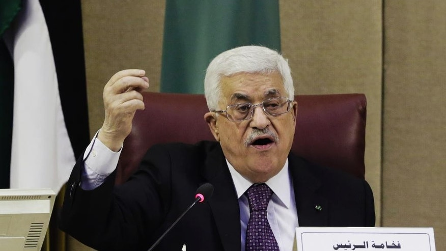 "Palestinian President Mahmoud Abbas speaks during an Arab foreign ministers meeting at the Arab League headquarters in Cairo, Egypt, Thursday, Jan. 15, 2015. Abbas asked the Arab League to provide a ""safety net"" of $100 million a month to cover tax revenues withheld by Israel in retaliation for his attempt to join the International Criminal Court. (AP Photo/Amr Nabil)"