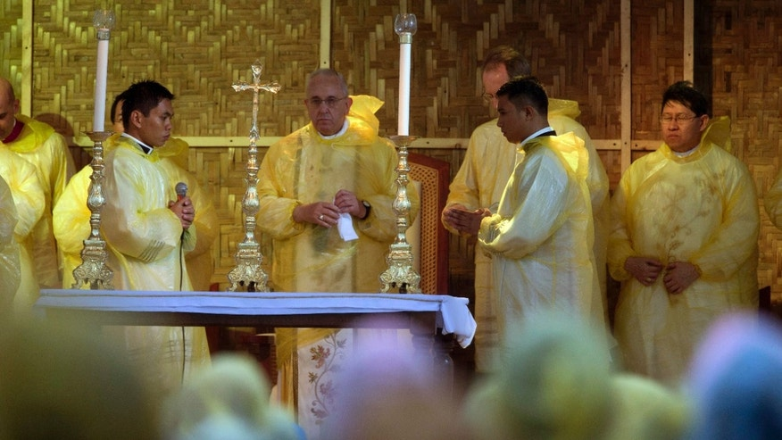 Jan. 17, 2015: Pope Francis, center, celebrates a mass in Tacloban, Philippines