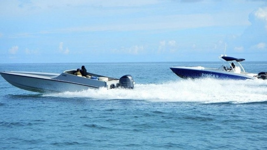 Sept. 18 2014: A maritime patrol aircraft detected this 40-foot go-fast vessel in the Caribbean Sea. DEA and Bahamian Police officials responded to the location and detained two suspects after locating 40 bales of marijuana. (U.S. Coast Guard photo)
