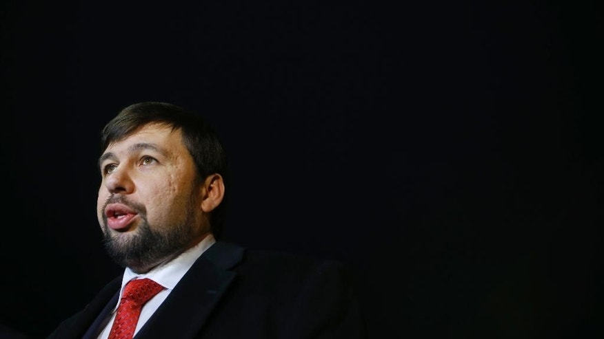 Denis Pushilin, leader of the insurgent Donetsk People's Republic, speaks to media at the National airport Minsk, before leaving, Belarus, Friday, Jan. 16, 2015. Representatives from Ukraine and Russia, separatist envoys and officials of the Organization for Security and Cooperation in Europe were tentatively set to hold talks Friday in Minsk, Belarus, on ensuring a cease-fire to be monitored by the OSCE. Prospects for Ukraine peace talks remained dim Friday as hostilities intensified between government forces and Russian-backed separatists in the east. (AP Photo/Sergei Grits)