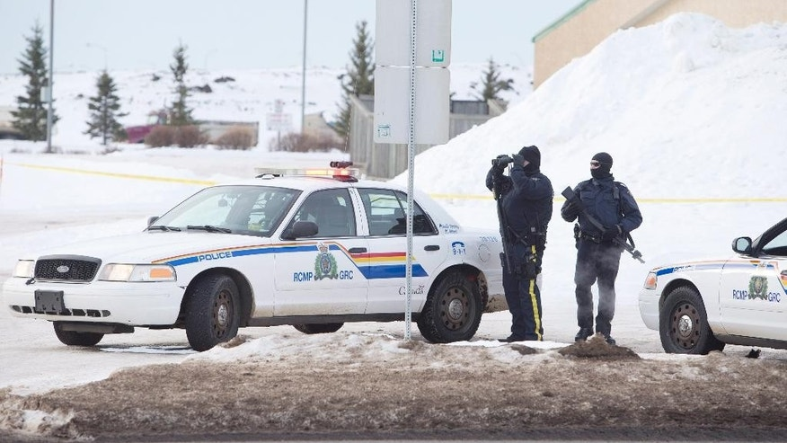 Jan 17. 2015: Police search for a suspect in the shooting of two RCMP officers in St. Albert, Alberta, Canada. (AP)