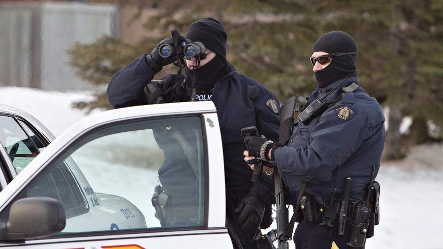 "Police search for a suspect in the shooting of two RCMP officers in St. Albert, Alberta, Canada, on Saturday, Jan. 17, 2015. St. Albert RCMP say the two officers were shot at about 3 a.m. inside the Apex Casino, northwest of Edmonton,  after responding to a stolen car investigation that led to ""an interaction with a civilian.""  The suspect is still at large and is considered to be armed and dangerous.  (AP Photo/The Canadian Press, Jason Franson)"