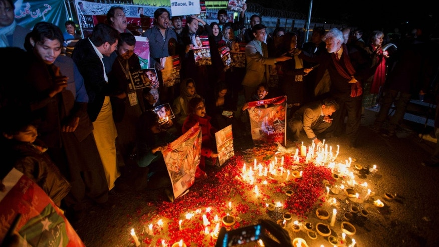 Jan. 16, 2015: Members of Pakistan's civil society groups light candles and shout anti-Taliban slogans to condemn the militant group's attack on a military-run school in Peshawar.