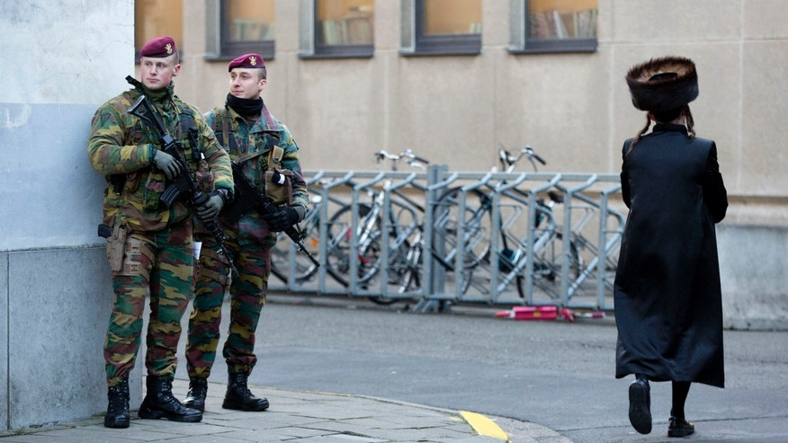 Jan. 17, 2015: Belgian para-commandos patrol near a synagogue in the center of Antwerp, Belgium.