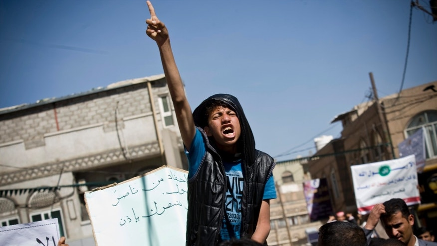 Jan. 17, 2015: A Yemeni youth chants slogans during a protest against caricatures published in French magazine Charlie Hebdo in front of the French Embassy in Sanaa, Yemen.