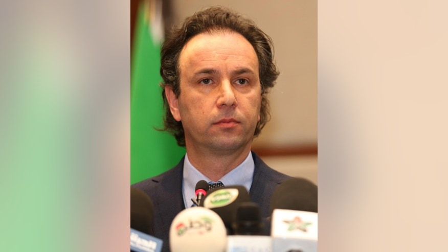 In this picture taken on January 5, 2015, released by the Syrian National Coalition Media Office, Khaled Khoja, the head of the Syrian National Coalition, speaks during a press conference, in Istanbul, Turkey. A Russian initiative to host peace talks this month between the Syrian government and its opponents appears to be unraveling, as prominent Syrian opposition figures shun the planned negotiations over concerns that the framework is flawed and holds little chance of success. (AP Photo/The Syrian National Coalition Media Office)