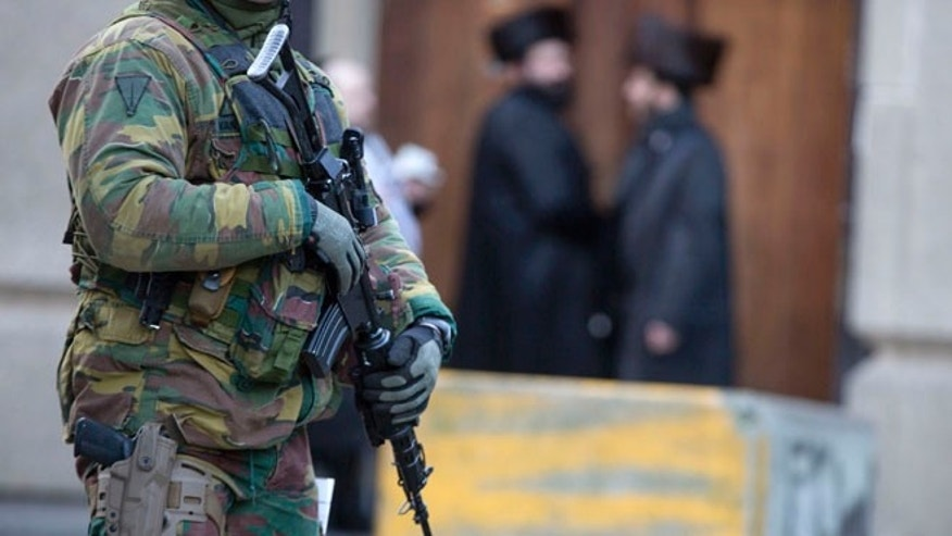 Jan. 17, 2015: Belgian para-commandos patrol near a synagogue in the center of Antwerp, Belgium. (AP)