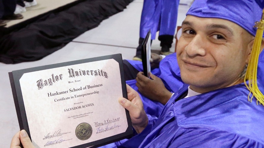 In this photo taken Dec. 12, 2014, prison inmate and graduate of the Prison Entrepreneurship Program Salvador Acosta proudly displays his Baylor Universityâs Hankamer School of Business  certificate of entrepreneurship during graduation ceremonies at the Cleveland Correctional Facility in Cleveland, Texas. The Prison Entrepreneurship Program, or PEP, is based on a philosophy that making inmates like Chavez business savvy will reduce the likelihood that theyâll end up back in prison. It emphasizes reforming behavior while also working on a broader goal of reducing the prison population. (AP Photo/Pat Sullivan)