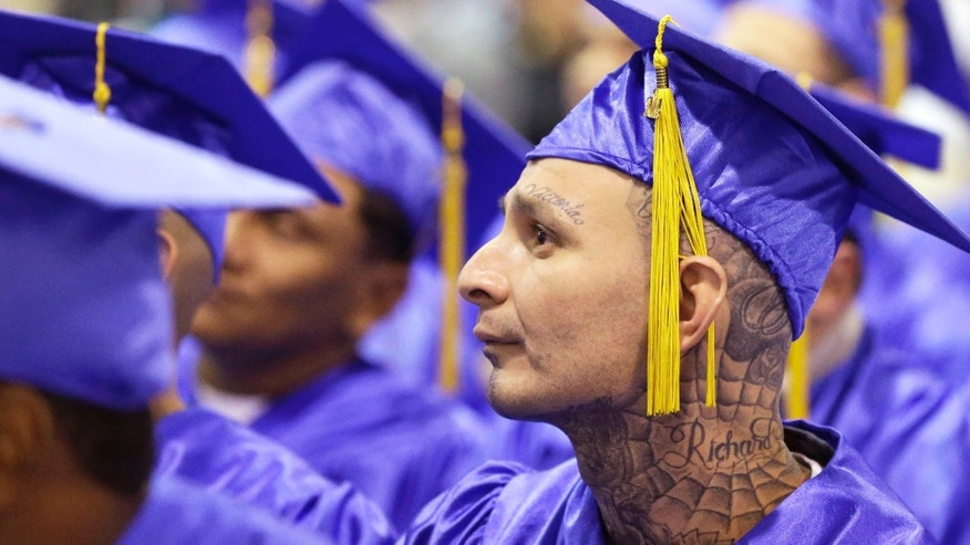 In this photo taken Dec. 12, 2014, prison inmate Richard Chavez sits with classmates and listens to a speaker during graduation ceremonies at the Cleveland Correctional Facility in Cleveland, Texas. The group is graduating from the Prison Entrepreneurship Program, or PEP. The program is based on a philosophy that making inmates like Chavez business savvy will reduce the likelihood that theyâll end up back in prison. (AP Photo/Pat Sullivan)