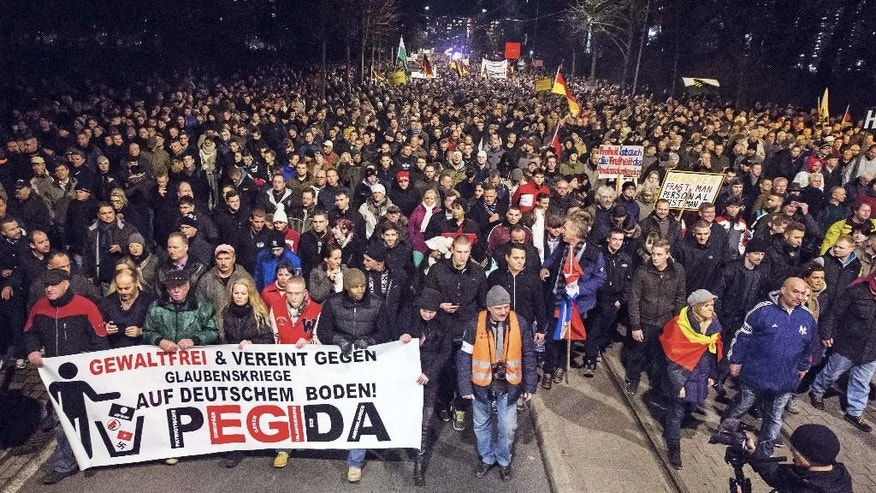 FILE - In this Dec. 15, 2014 file photo thousands of participants of a rally called 'Patriotic Europeans against the Islamization of the West' (PEGIDA) gather in Dresden, eastern Germany.  The  group  said Sunday Jan. 18, 2015  it is calling off a rally planned next week in the city of Dresden because of a threat against one of its organizers. The group calling itself PEGIDA, or Patriotic Europeans against the Islamization of the West, has organized rallies every Monday in the eastern German city. Last week's event drew the biggest crowd yet, with police estimating some 25,000 people attended.  It called on supporters to instead hang flags out of their windows and light candles on Monday evening.  Banner reads :  Nonviolent  and  United against Faith Wars on German soil. AP Photo/Jens Meyer)