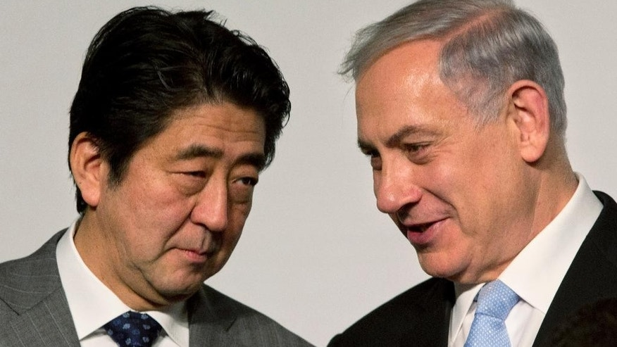 Japan's Prime Minister Shinzo Abe, left, speaks with Israeli Prime Minister Benjamin Netanyahu during a conference in Jerusalem, Sunday, Jan. 18, 2015. Abe is on his six-day visit to the Middle East. (AP Photo/Sebastian Scheiner)