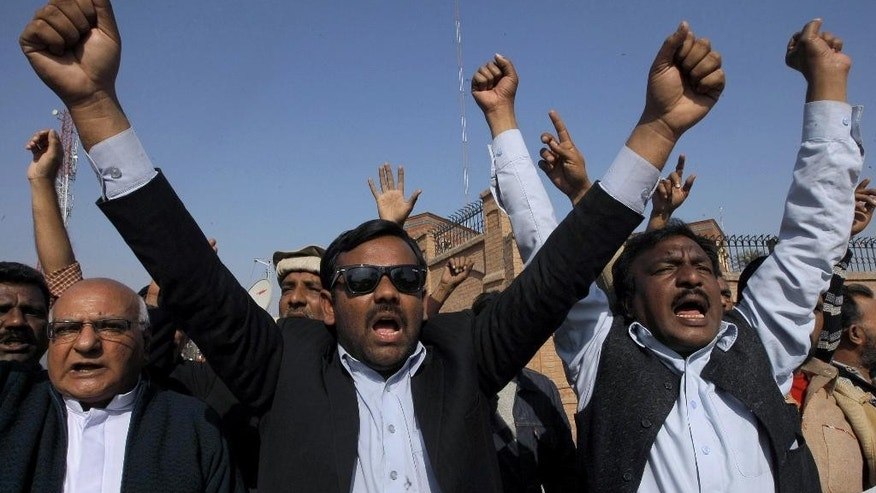 Members of United Christian Movement chant slogans during demonstration against caricatures published in French magazine Charlie Hebdo, in Peshawar, Pakistan, Sunday, Jan. 18, 2015.  Dozens of people of Pakistani Christian community demonstrated in Peshawar against the satirical newspaper Charlie Hebdo and its publication of cartoons depicting the Prophet Muhammad. (AP Photo/Muhammad Sajjad)