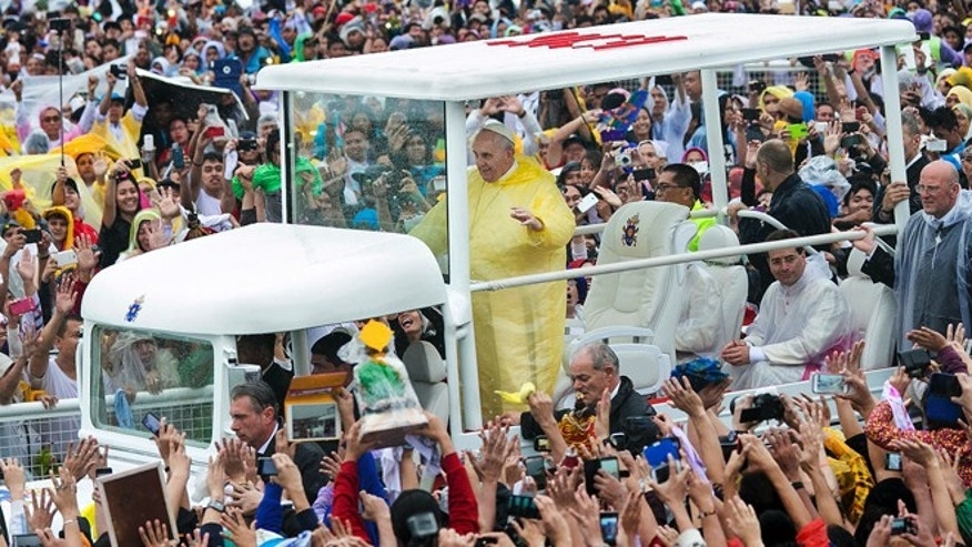 Jan. 18, 2015: Pope Francis waves to the crowd as he arrives at Quirino Grandstand to celebrate his final Papal Mass in Manila, Philippines