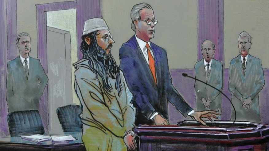 FILE - This March 10, 2009, file image of a courtroom drawing from U.S. District Court shows alleged al-Qaida sleeper agent Ali al-Marri as he made an initial appearance with his attorney Andy Savage in Charleston, S.C. to face terror charges for the first time after being held for more than five years as an enemy combatant. Nephew Saleh Garallah Kahlah al-Marri said Sunday, Jan. 18, 2015, that Ali al-Marri, a Qatari man declared an enemy combatant by the U.S. and imprisoned for years over terrorist links, returned home to the Gulf nation Saturday night. (AP Photo/Richard Miller, File)