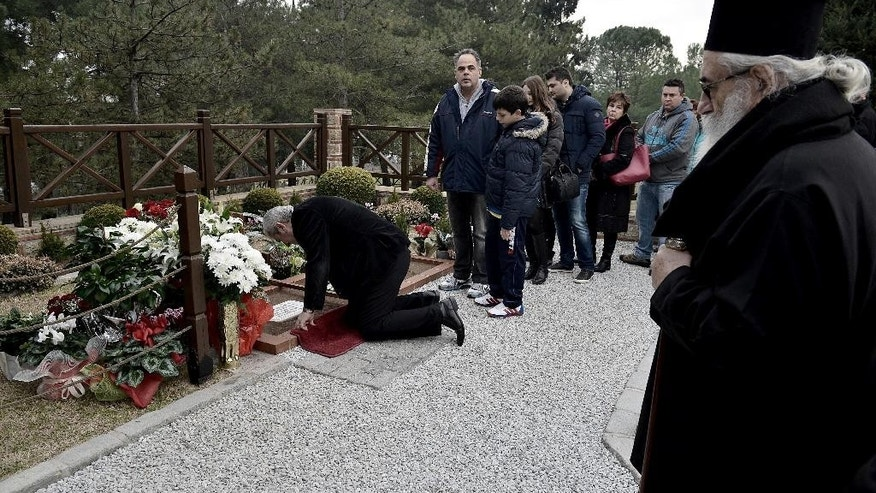 Damianos, Archbishop of Sinai looks at the crowds of Christian Orthodox faithful waiting in line to visit the grave of St. Paisios in a monastery in the town of Souroti, about 30 kilometers (18 miles) east of Thessaloniki, northern Greece, on Sunday, Jan. 18, 2015. Paisios, a monk who spent most of his life in the Mt. Athos monastic community, is the Orthodox Church's newest saint, was canonized last Tuesday, in an unusually short time (20 years, 6 months) after his death, in part due to his popularity among the faithful, who considered him a wise man and a prophet. (AP Photo/Giannis Papanikos)