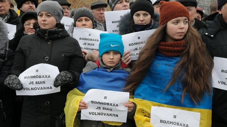 Jan. 18, 2015: People hold signs that read: 'I am Volnovakha' during a rally on Independence Square in Kiev, Ukraine, in solidarity with the victims of a rocket attack this week that claimed 13 lives on a highway near the eastern town of Volnovakha. (AP)